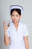 Young Asian nurse with pure water Stock Photo