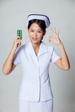 Young Asian nurse show OK with pack of tablet Stock Photos