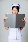 Young Asian nurse smile with a folder Stock Photos