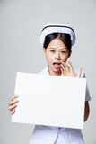 Young Asian nurse surprise with blank sign Stock Photo