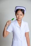 Young Asian nurse with syringe Stock Image