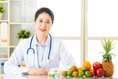 Young asian nutritionist recommend eating fruits Royalty Free Stock Photo