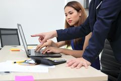 Young Asian partner working together in office. Teamwork business concept royalty free stock image