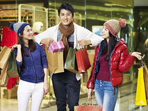 Young asian people enjoying shopping in mall Stock Images