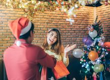Young Asian people are happy to receive gifts on Christmas Eve. royalty free stock photo