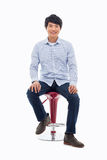 Young Asian person sitting on the chair. Stock Image