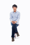 Young Asian person sitting on the chair. Stock Photo