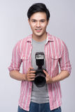Young asian photographer holding digital camera, while working i. N studio royalty free stock photos