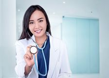 Young asian physician woman holding stethoscope. On the clinic Stock Photo