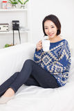 Young Asian pretty woman having a cup of coffee. Stock Photography
