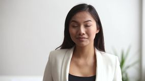 Young asian professional businesswoman looking at camera in office. Confident millennial office worker in formal wear smiling, chinese staff manager, korean stock video