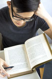 Young asian reading text Stock Image