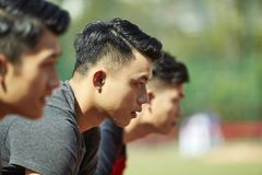 Young asian runners on starting line. Close-up of faces of young asian adult runners on starting line Stock Photos