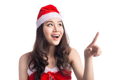 Young asian santa woman pointing up using index finger, isolated Royalty Free Stock Images