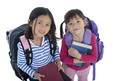 Young Asian School Girls. Two very cute asian girl with a pretty smiles ready for school Royalty Free Stock Photo