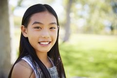 Young Asian schoolgirl smiling to camera, close up royalty free stock photos