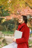 Young asian sensual woman reading a book in romantic autumn scenery.Portrait of pretty young girl in autumnal forest Royalty Free Stock Images