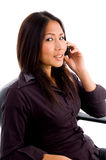 Young asian service provider busy on cell phone royalty free stock images