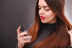 Young asian sexy woman with dark hair using red lipstick.  Stock Photo