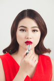 Young asian woman with dark hair using red lipstick Stock Image