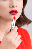 Young asian sexy woman with dark hair using red lipstick.  Royalty Free Stock Images