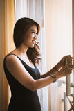 Young Asian sexy woman standing in black dress Royalty Free Stock Image