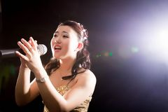Singing woman of Asia stock images