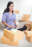 Young Asian small business owner at home office, online marketing packaging and delivery. Start up small business entrepreneur SME or freelance woman working at Stock Image