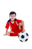 Young asian soccer player with football smiling. Isolated on whi Royalty Free Stock Photography