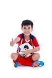 Young asian soccer player with soccer smiling and holding soccer Royalty Free Stock Images