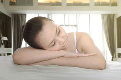 Young asian spa girl lean back on her arm Stock Images