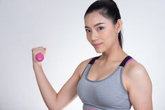 Young asian sporting woman training with dumbbell. Pretty athlet Royalty Free Stock Photo