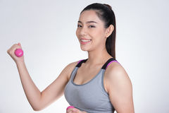 Young asian sporting woman training with dumbbell. Pretty athlet Royalty Free Stock Images