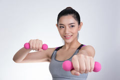 Young asian sporting woman training with dumbbell. Pretty athlet Stock Photography