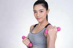 Young asian sporting woman training with dumbbell. Pretty athlet Royalty Free Stock Photography