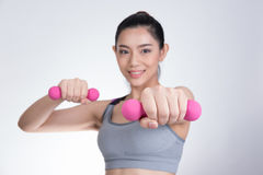 Young asian sporting woman training with dumbbell. Pretty athlet Stock Image