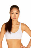Young Asian in Sports Bra Looking at Camera. Beautiful Young Asian in Sports Bra Looking at Camera Stock Photos