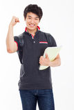 Young Asian stdudent showing fist. Stock Photography