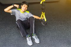 Young asian strong man holding lifeline pull up revolution getti stock photos