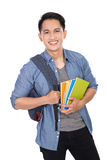 Young asian student with a backpack on and holding books. A portrait of a young asian student with a backpack on and holding books Royalty Free Stock Photo