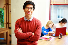 Young asian student in classroom. Happy young asian student in classroom Stock Image