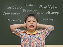 Young Asian student covering ears Royalty Free Stock Photography