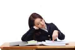 Young Asian student having trouble on desk. Royalty Free Stock Images
