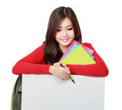 Young asian student holding empty white board Royalty Free Stock Photo