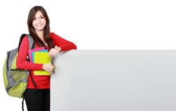 Young asian student holding empty white board Stock Image