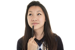 Young Asian student isolated on white background Stock Images