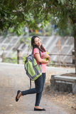 Young Asian student outdoor, posing cutely to the camera. A portrait of a young Asian students outdoor, posing cutely to the camera Royalty Free Stock Photo