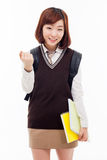 Young pretty Asian student showing fist. Young Asian student showing fist isolated on white background Royalty Free Stock Photography