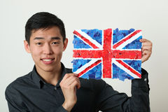 Young Asian student showing UK national flag Stock Image