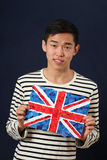 Young Asian student showing UK national flag Royalty Free Stock Photo